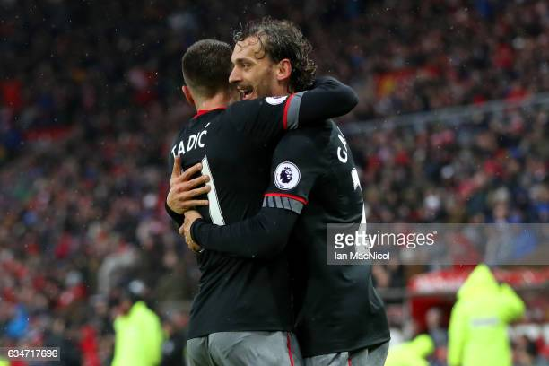 Manolo Gabbiadini of Southampton celebrates scoring the opening goal with his team mate Dusan Tadic during the Premier League match between...