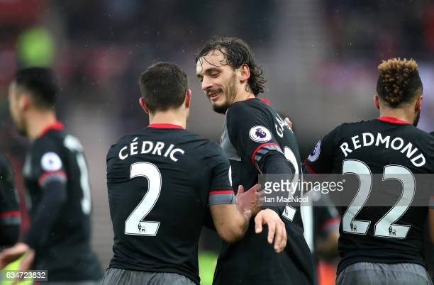 Manolo Gabbiadini of Southampton celebrates scoring the opening goal with his team mate Cedric Soares during the Premier League match between...