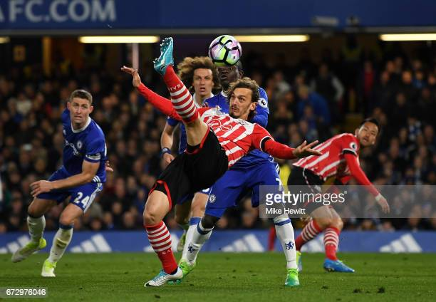 Manolo Gabbiadini of Southampton is marshalled by N'Golo Kante of Chelsea during the Premier League match between Chelsea and Southampton at Stamford...