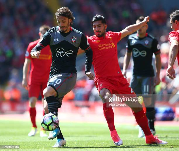 Manolo Gabbiadini of Southampton is put under pressure from Emre Can of Liverpool during the Premier League match between Liverpool and Southampton...