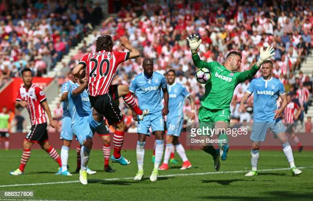 Manolo Gabbiadini of Southampton sees his shot saved by Jack Butland of Stoke City during the Premier League match between Southampton and Stoke City...