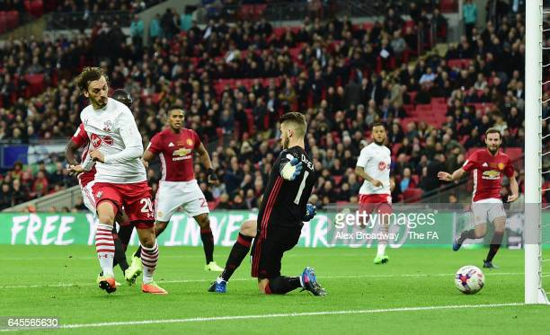Manolo Gabbiadini of Southampton shoots past goalkeeper David De Gea of Manchester United to score their first goal during the EFL Cup Final between...