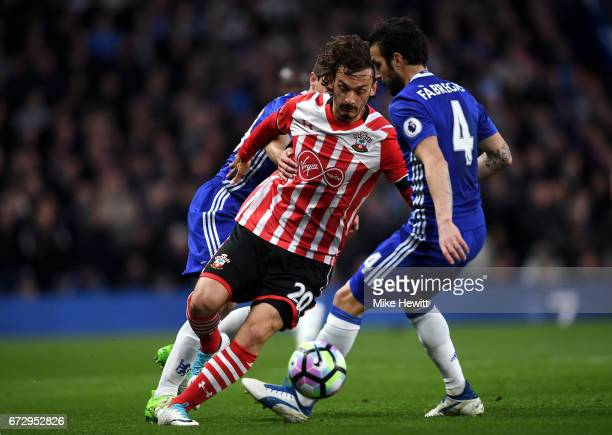 Manolo Gabbiadini of Southampton takes on Cesc Fabregas of Chelsea during the Premier League match between Chelsea and Southampton at Stamford Bridge...