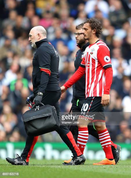 Manolo Gabbiadini of Southampton walks off inured during the Premier League match between Tottenham Hotspur and Southampton at White Hart Lane on...