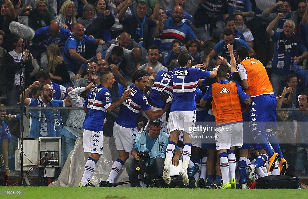 Manolo Gabbiadini of UC Sampdoria celebrates with his teammates after scoring the opening goal during the Serie A match between Genoa CFC and UC...