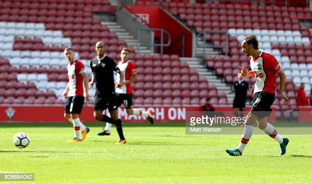 Manolo Gabbiadini scores Southampton's second during the preseason friendly between Southampton FC and Sevilla at St Mary's Stadium on August 5 2017...