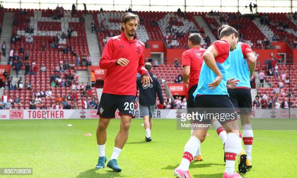 Manolo Gabbiadini warms up ahead of the Premier League match between Southampton and Swansea City at St Mary's Stadium on August 12 2017 in...