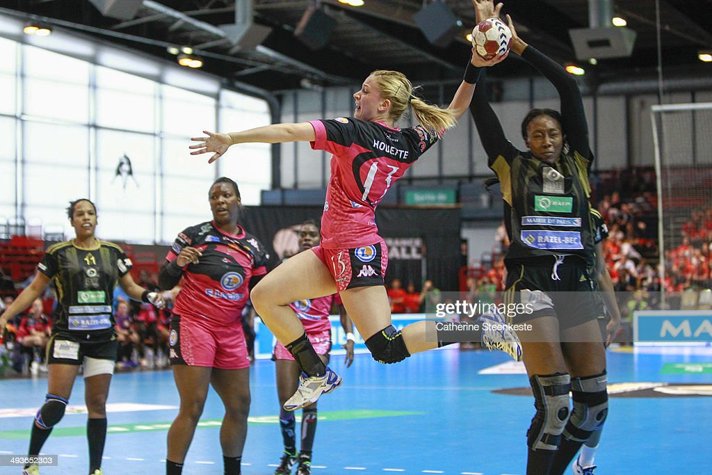 Manon Houette #13 of Fleury Loiret Handball shoots the ball against <a gi-track='captionPersonalityLinkClicked' href=/galleries/search?phrase=Mariama+Signate&family=editorial&specificpeople=2206555 ng-click='$event.stopPropagation()'>Mariama Signate</a> #24 of Issy Paris Hand during the women final game of the French National Cup between Fleury Loiret Handball and Issy Paris Hand at La Halle Carpentier on May 24, 2014 in Paris, France.