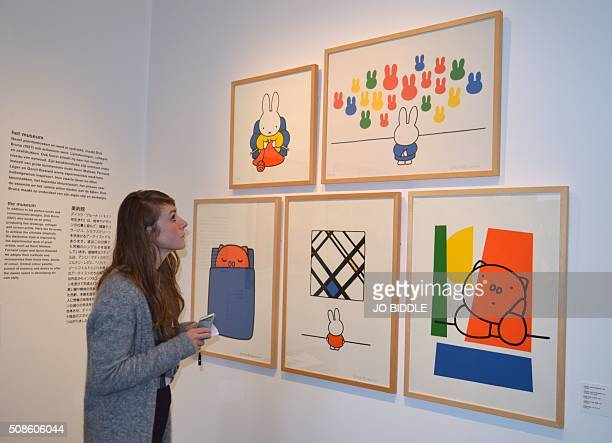 Manou Nonnekes marketing and communications officer of the Miffy Museum looks at prints on display at the museum in Utrecht on February 3 2016 To...
