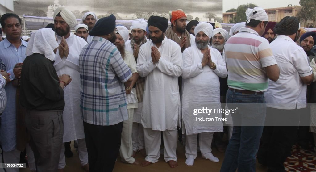 Manpreet Singh 'Monty', son of Gurdeep Singh 'Ponty' Chadha, with relatives after the Antim Ardas (funeral rites) of his father and uncle Hardeep Singh Chadha at Gurudwara Rakabganj Sahib on November 22, 2012 in New Delhi, India. Liquor Baron Ponty Chadha and his brother were killed in a gun battle over property dispute.