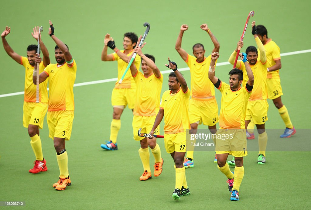 <a gi-track='captionPersonalityLinkClicked' href=/galleries/search?phrase=Manpreet+Singh+-+Field+Hockey+Player&family=editorial&specificpeople=16029378 ng-click='$event.stopPropagation()'>Manpreet Singh</a> (#7) of India and his team-mates celebrate winning the Men's Semi-Final match between New Zealand and India at Glasgow National Hockey Centre during day ten of the Glasgow 2014 Commonwealth Games on August 2, 2014 in Glasgow, United Kingdom.