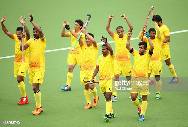 Manpreet Singh of India and his teammates celebrate winning the Men's SemiFinal match between New Zealand and India at Glasgow National Hockey Centre...