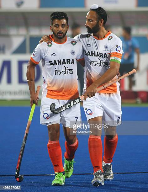 Manpreet Singh of India and Sardar Singh captain of India during the match between Argentina and India on day one of The Hero Hockey League World...