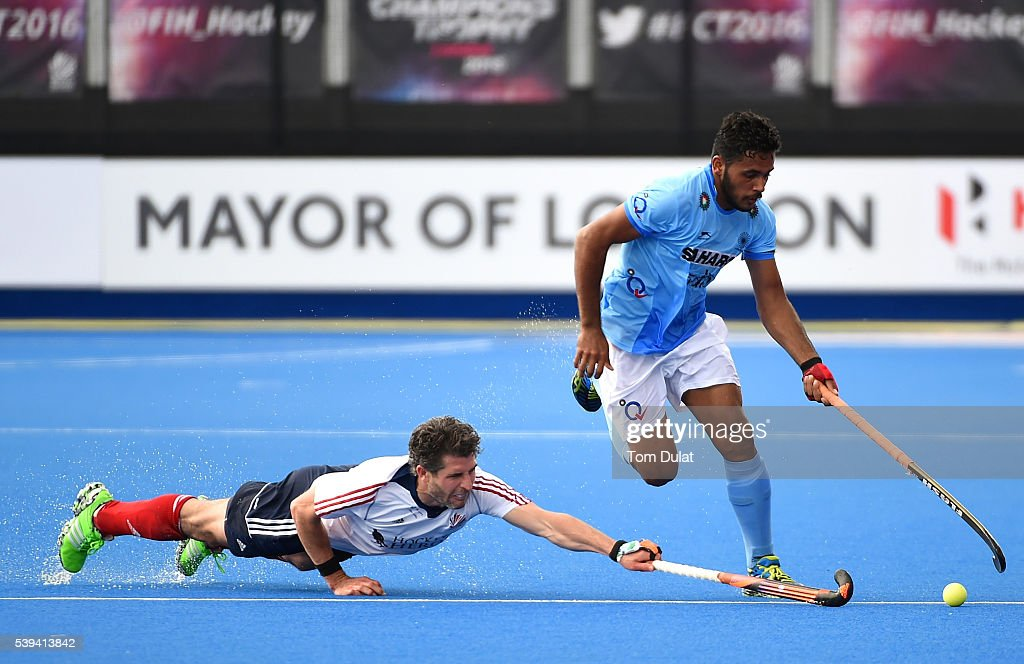 <a gi-track='captionPersonalityLinkClicked' href=/galleries/search?phrase=Manpreet+Singh+-+Field+Hockey+Player&family=editorial&specificpeople=16029378 ng-click='$event.stopPropagation()'>Manpreet Singh</a> of India and Simon Mantell of Great Britain in action during day two of the FIH Men's Hero Hockey Champions Trophy 2016 match between India and Great Britain at Queen Elizabeth Olympic Park on June 11, 2016 in London, England.