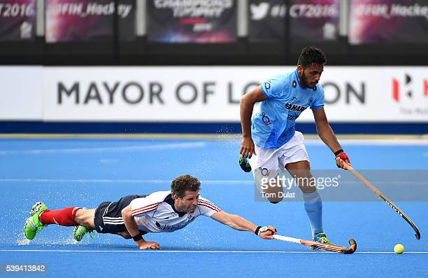 Manpreet Singh of India and Simon Mantell of Great Britain in action during day two of the FIH Men's Hero Hockey Champions Trophy 2016 match between...