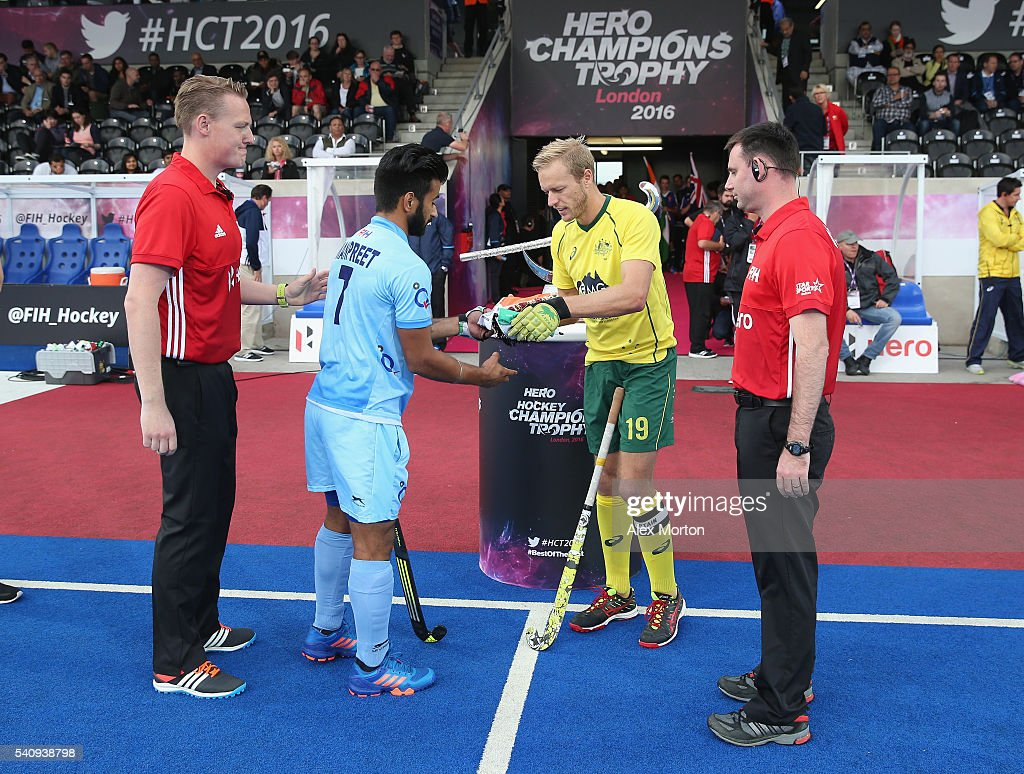 <a gi-track='captionPersonalityLinkClicked' href=/galleries/search?phrase=Manpreet+Singh+-+Field+Hockey+Player&family=editorial&specificpeople=16029378 ng-click='$event.stopPropagation()'>Manpreet Singh</a> of India and Tim Deavin of Australia with match umpires prior to the FIH Mens Hero Hockey Champions Trophy 1st-2nd place match between Australia and India at Queen Elizabeth Olympic Park on June 17, 2016 in London, England.
