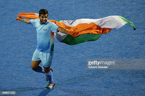 Manpreet Singh of India celebrates after defeating Pakistan during the men's hockey gold medal match on day thirteen of the 2014 Asian Games between...