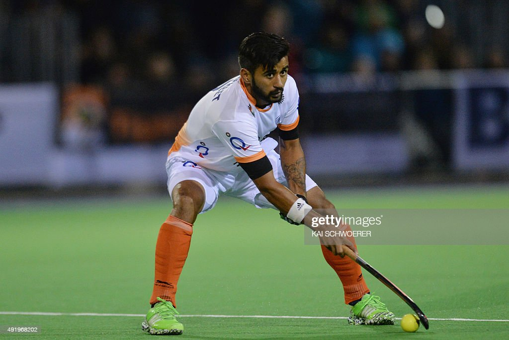 <a gi-track='captionPersonalityLinkClicked' href=/galleries/search?phrase=Manpreet+Singh+-+Field+Hockey+Player&family=editorial&specificpeople=16029378 ng-click='$event.stopPropagation()'>Manpreet Singh</a> of India passes the ball during the international men's hockey test match between the New Zealand Black Sticks and India on October 9, 2015 in Christchurch, New Zealand.