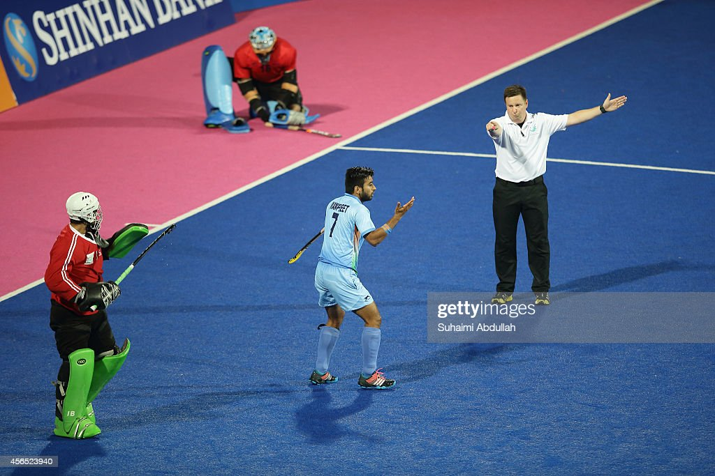 <a gi-track='captionPersonalityLinkClicked' href=/galleries/search?phrase=Manpreet+Singh+-+Field+Hockey+Player&family=editorial&specificpeople=16029378 ng-click='$event.stopPropagation()'>Manpreet Singh</a> of India (C) reacts to the referee decision during the penalty shootout in the men's hockey gold medal match on day thirteen of the 2014 Asian Games between India and Pakistan at Seonhak Hocky Stadium on October 2, 2014 in Incheon, South Korea.