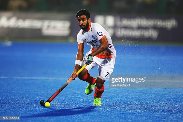 Manpreet Singh of India runs with the ball during the match between India and Belgium on day nine of The Hero Hockey League World Final at the Sardar...