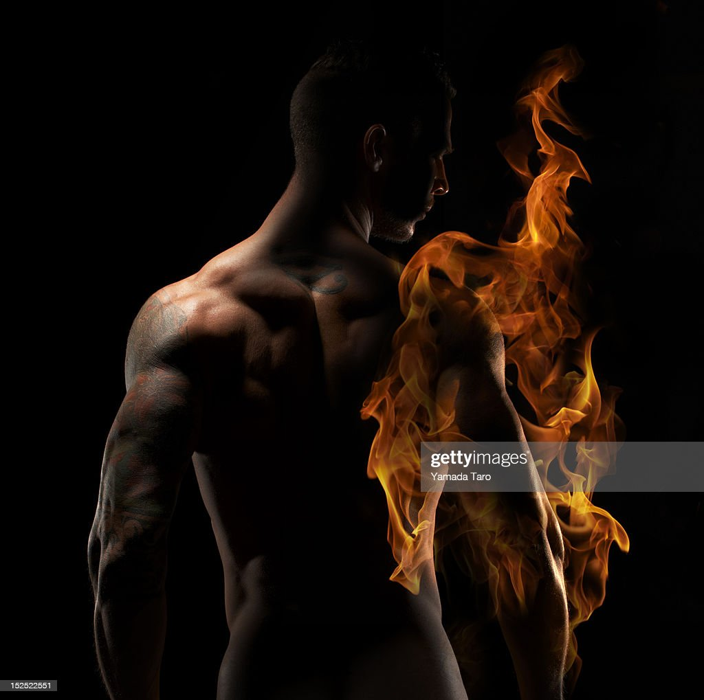 Man's arm in fire flame : Stockfoto