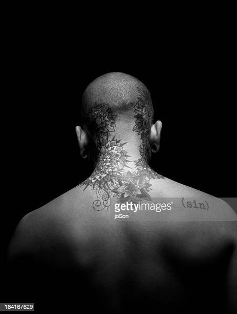 Man's back with tattoo, rear view