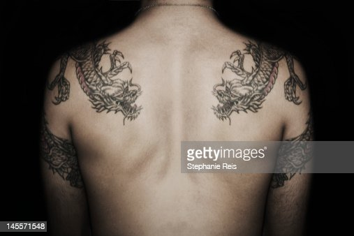 Man's back with tattoos : Stock Photo