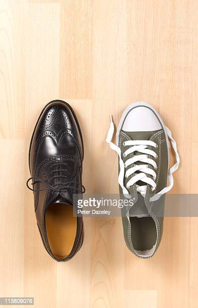 Mans business shoe and trainer