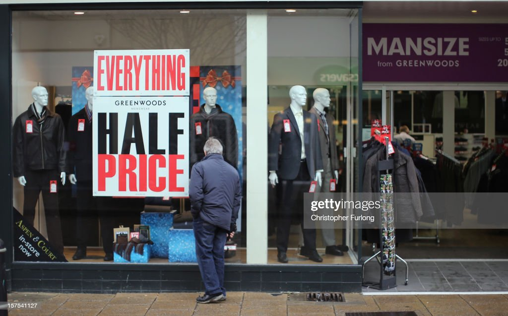 A mans clothing shop entices customers with a half price sale on December 4, 2012 in Rotherham, United Kingdom. Retailers across Britain are struggling as people wait for bigger discounts before spending for the Christmas period. The British Retail Consortium (BRC) said that it's members were in a 'state of nervousness' in the last weeks of the festive period.