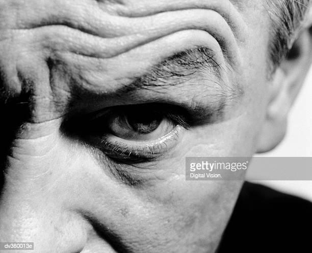 Man's eye with raised eyebrow