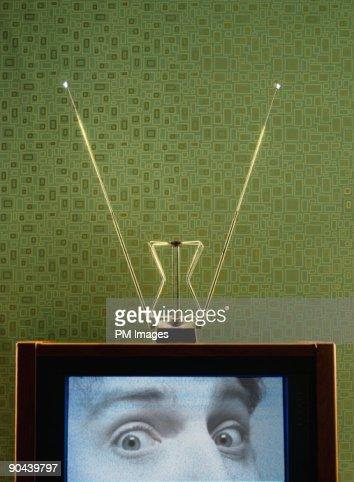 Man's eyes on Vintage Television