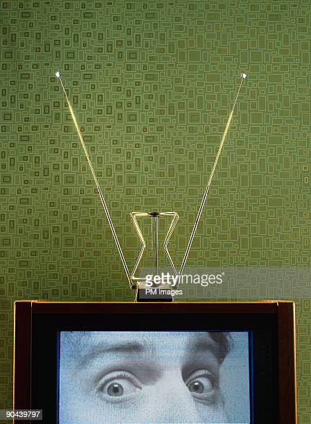 Man's eyes on Vintage Television