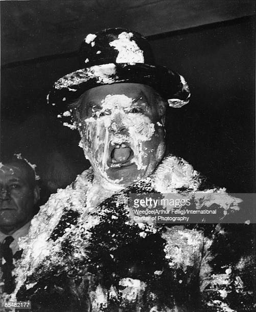 A man's face is covered in cream as a result of a pie fight in the War Room on the set of Stanley Kubrick's movie 'Dr Strangelove Or How I Learned to...