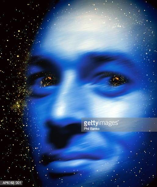 Man's face with images of Saturn in eyes (Digital Composite)