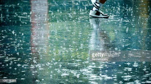 Man's Feet in the Rain