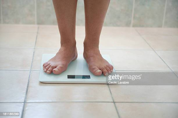 Man's feet on a weighing scale