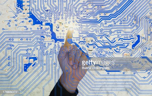 man's finger pointing a circuit board : Stock Photo