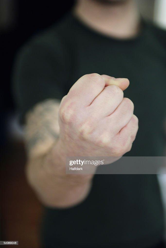 A man?s fist : Stock Photo