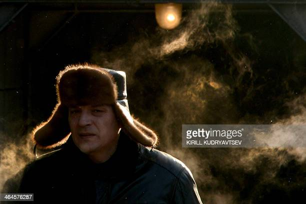A man's frozen breath hangs in the air in central Moscow on January 23 2014 The temperatures in the Russian capital dropped today to 13 C but due to...
