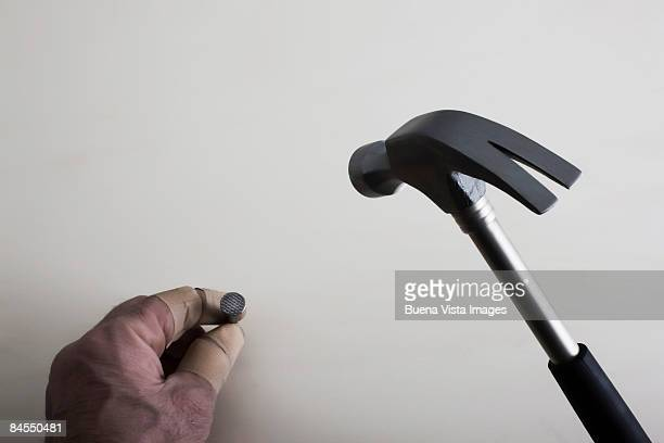 Man's hand and hammer