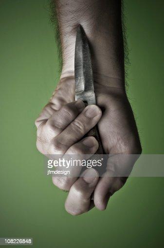 Man's Hand Holding Dagger Knife