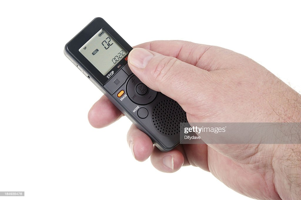 Mans Hand Holding Digital Voice Recorder