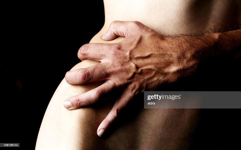 naked men holding hands
