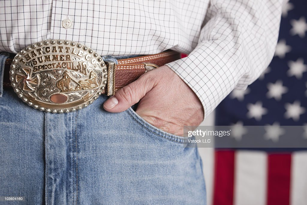 Man's hand in the pocket of his jeans