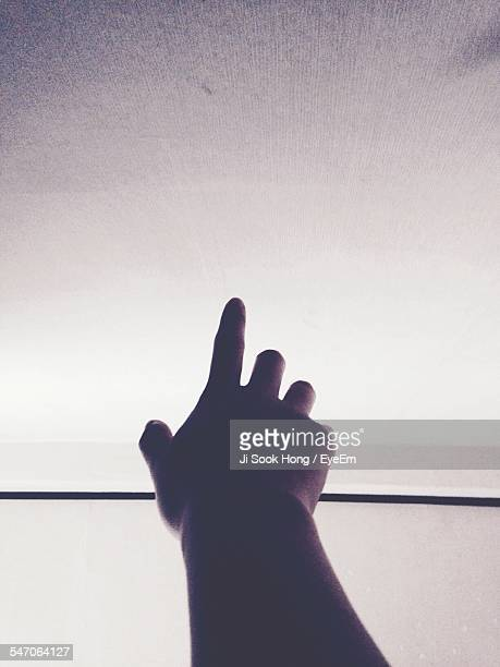Mans Hand Reaching For Sky