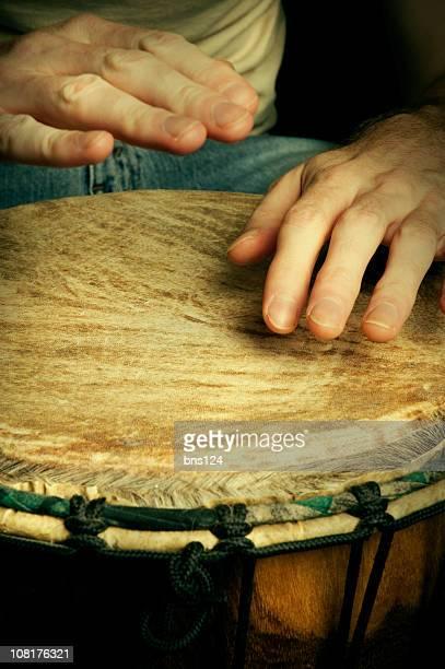 Man's Hands Drumming on Bongo Drum
