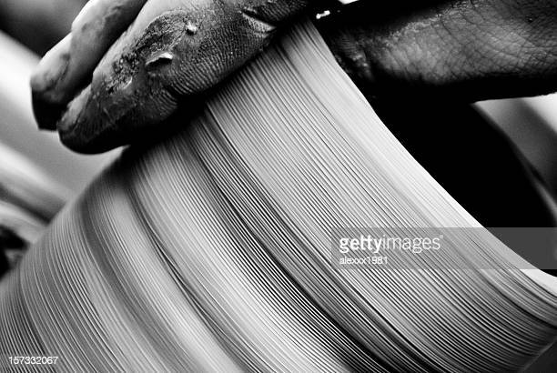 Man's Hands Making Clay Pot on Wheel