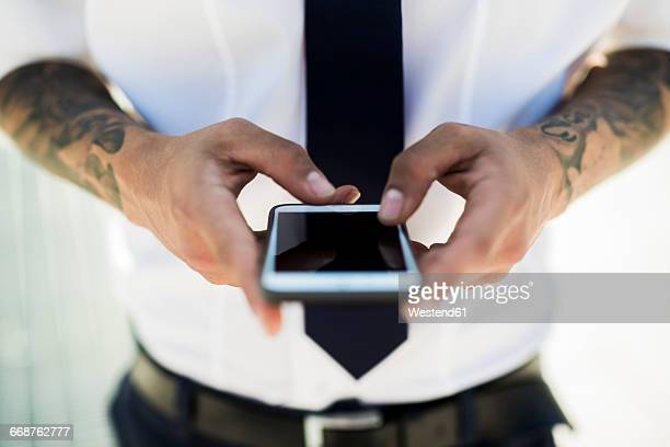 Mans hands text messaging, close-up