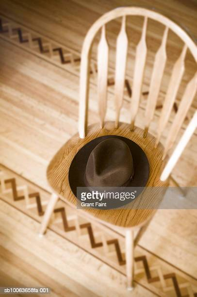 Man's hat on chair, high angle view