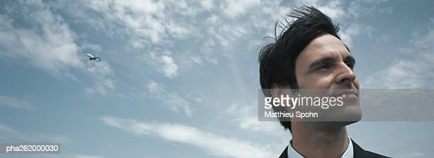 Man's head with sky in background, low angle view